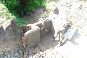 The Water Project: Mukhuyu Community, Namukuru Spring -  Construction Of The Headwall And Wing Walls