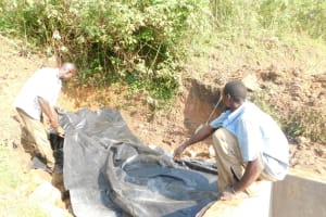 The Water Project: Mukhuyu Community, Namukuru Spring -  Covering With Plastic Sheeting