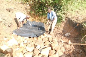 The Water Project: Mukhuyu Community, Namukuru Spring -  Covering With Plastic