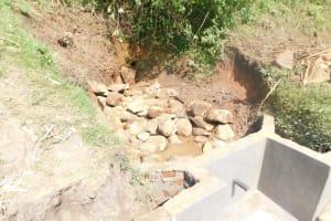The Water Project: Mukhuyu Community, Namukuru Spring -  Layer Of Large Rocks