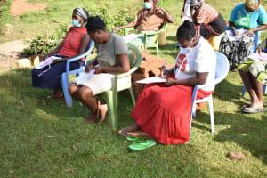 The Water Project: Mukhuyu Community, Namukuru Spring -  Participants Keenly Taking Notes