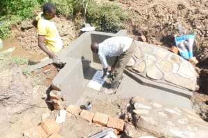 The Water Project: Mukhuyu Community, Namukuru Spring -  Placing Of Tiles