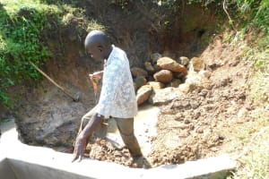 The Water Project: Mukhuyu Community, Namukuru Spring -  Reinforcing Head And Wing Walls With Clay