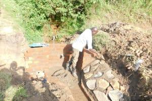 The Water Project: Mukhuyu Community, Namukuru Spring -  Stone Pitching