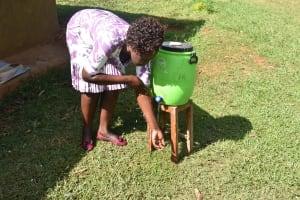 The Water Project: Mukhuyu Community, Namukuru Spring -  Trainer Joyce Rinsing Hands