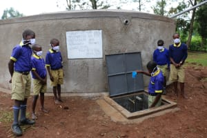 The Water Project: Mungabira Primary School -  Confirmed Clean Water Flowing