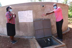 The Water Project: Mungabira Primary School -  Field Officer Edmond Handing Over Tank