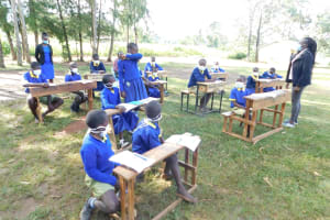 The Water Project: Mungabira Primary School -  Learning To Cover Sneezes And Coughs