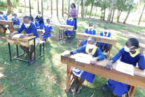 The Water Project: Mungabira Primary School -  Sanitation Teacher Attending Training