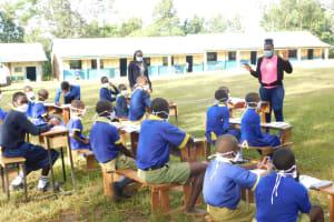 The Water Project: Mungabira Primary School -  Trainer Joyce In Action