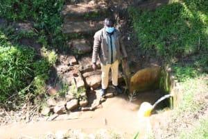 The Water Project: ACK St. Luke's Shanderema Primary School -  Mr Mukola Fetching Water