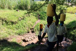 The Water Project: ACK St. Luke's Shanderema Primary School -  Students Carrying Water