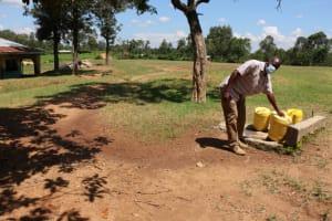 The Water Project: Bumwende Primary School -  Robert Indakwa Fetching Water