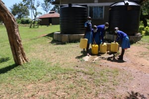 The Water Project: Bumwende Primary School -  Students Collecting Water