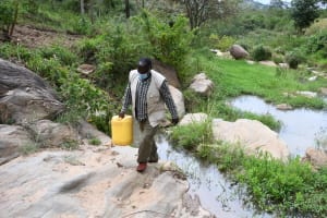 The Water Project: Kyamwau Community B -  Carrying Water Home