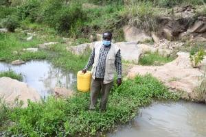 The Water Project: Kyamwau Community B -  Carrying Water