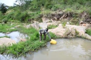 The Water Project: Kyamwau Community B -  Fetching Water