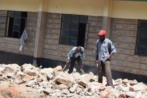 The Water Project: Kikumini Boys Secondary School -  People Lift Stones