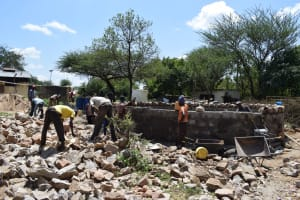 The Water Project: Kikumini Boys Secondary School -  People Use Gathered Rocks For Building The Tank