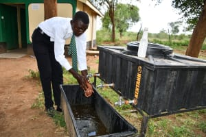The Water Project: Kikumini Boys Secondary School -  Using The New Handwashing Station