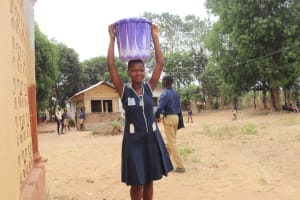 The Water Project: Kingsway Secondary School -  Student Carrying Water
