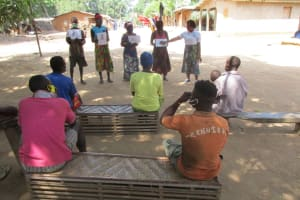 The Water Project: Kamasondo, Masome Village -  Holding Up Posters