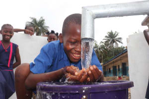 The Water Project: St. Peter Roman Catholic Primary School -  Drinking From The Well
