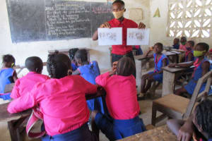 The Water Project: St. Peter Roman Catholic Primary School -  Holding Up Training Posters