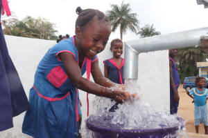 The Water Project: St. Peter Roman Catholic Primary School -  Student Celebrates The Well
