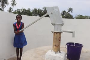 The Water Project: St. Peter Roman Catholic Primary School -  Student Pumps The Well