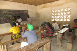 The Water Project: St. Peter Roman Catholic Primary School -  Teacher Constructing Tippy Tap