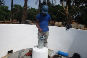 The Water Project: DEC Kitonki Primary School -  Checking The Depth Of The Well And The Water