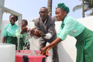 The Water Project: DEC Kitonki Primary School -  Head Teacher And Students Celebrate