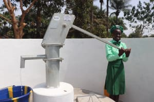 The Water Project: DEC Kitonki Primary School -  Student Pumps The Well