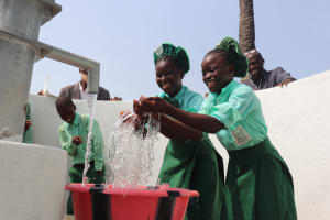 The Water Project: DEC Kitonki Primary School -  Students Happily Splashing Water
