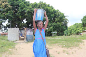 The Water Project: Lungi, Tardi, St. Monica's RC Primary School -  Student Carrying Water