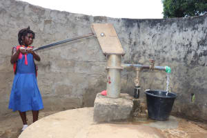 The Water Project: Lungi, Tardi, St. Monica's RC Primary School -  Student Collecting Water