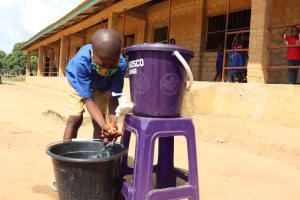The Water Project: Lungi, Tardi, St. Monica's RC Primary School -  Student Deomonstrating Hand Washing