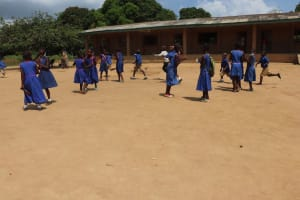The Water Project: Lungi, Tardi, St. Monica's RC Primary School -  Students Outside Classroom Playing