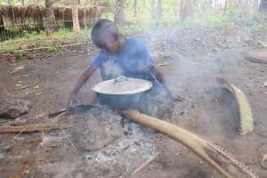 The Water Project: Kamasondo, Feradugu Village -  Small Boy Cooking Food