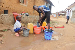 The Water Project: Lungi, Masoila, Lower Kamara St Mosque -  Young Boy Laundering