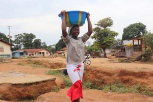 The Water Project: Lungi, Masoila, Lower Kamara St Mosque -  Young Girl Carrying Water
