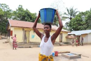 The Water Project: Kamasondo, Makontho Village -  Woman Carrying Water