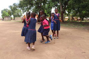 The Water Project: Saint Paul's Roman Catholic Primary School -  Students Outside Classroom Playing