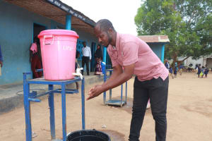 The Water Project: SLMC Primary School -  Teacher Demonstrating Hand Washing