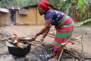 The Water Project: Kamasondo, Raka Village -  Woman Baking Bread