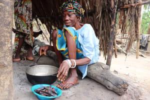 The Water Project: Kamasondo, Raka Village -  Woman Cleaning Fish