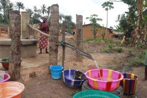 The Water Project: Kamasondo, Raka Village -  Woman Collecting Water