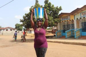 The Water Project: Rotifunk, #4 Abidjan Street -  Carrying Water