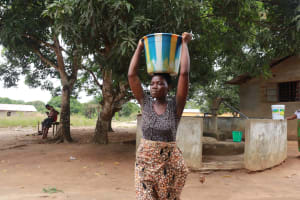 The Water Project: Masoila, 28 Conteh Street -  Lady Carrying Water
